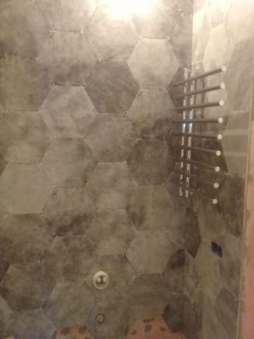 Работы по укладке керамогранита в ванной